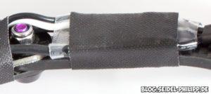 Im Schrumpschlauch mit Gewebeband hingebunden